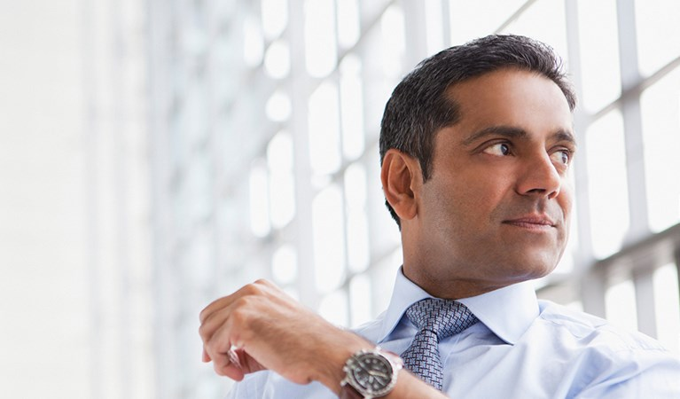 Businessman in the office looking over his shoulder