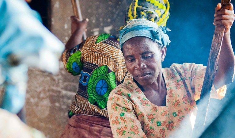 African woman making food