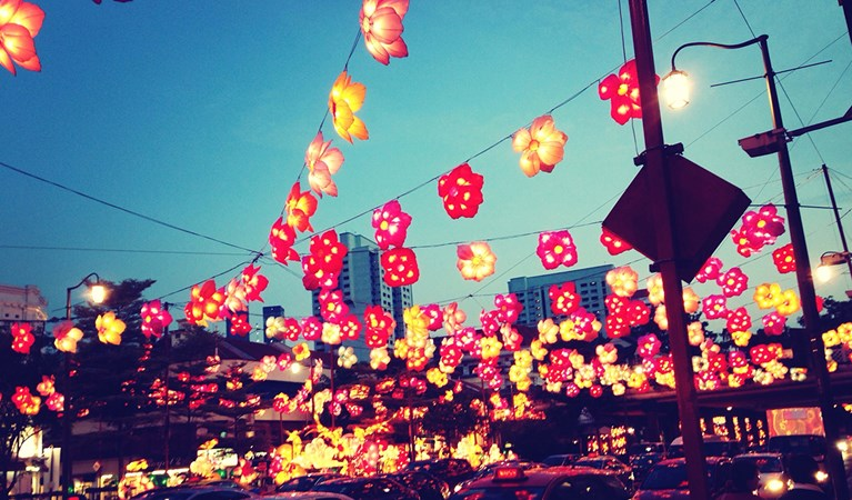 Flower Shaped Lanterns Over Traffic