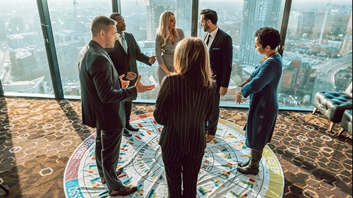 A group of people standing on the Insights archetype wheel