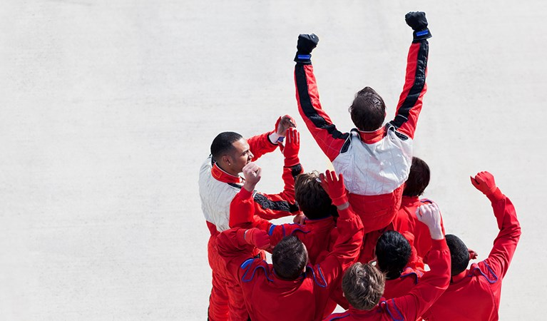 F1 racing team celebrating an achievement